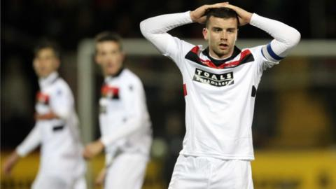 Crusaders captain Colin Coates reacts after a missed opportunity as the final ends scoreless after extra-time