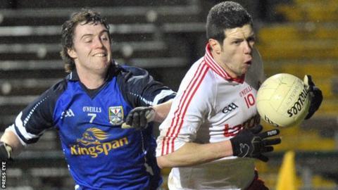Cavan's Damien O'Reilly tracks Sean Cavanagh of Tyrone
