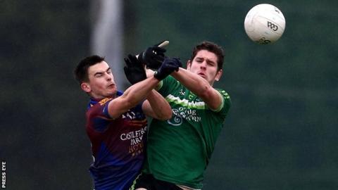 Limerick's Eoin Carroll battles with QUB's Harry Og Conlon at the Dub