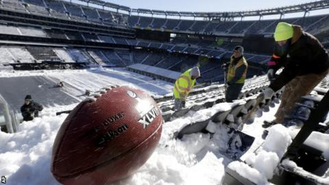 Super Bowl XLVIII - workers clear the snow and ice from Metlife Stadium