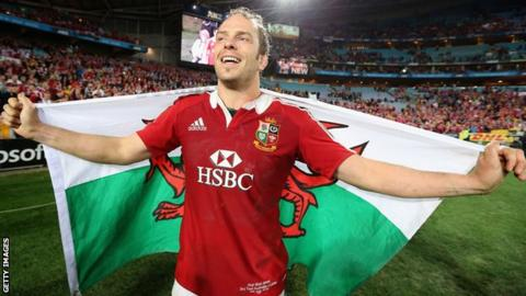 Alun Wyn Jones drapes himself in a Welsh flag after captaining the Lions to victory over Australia
