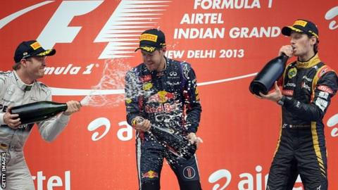 Sebastian Vettel is drenched in champagne