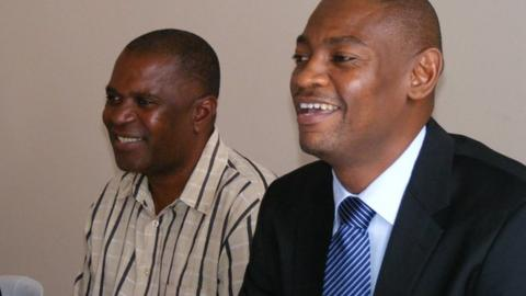 New Malawi coach Young Chimodzi and FAM president Walter Nyamilandu