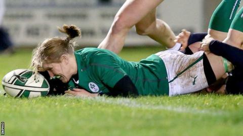 Heather O'Brien scores Ireland's third try against Scotland