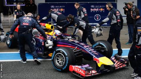 Red Bull's Daniel Ricciard is pushed back into his team garage during day four of testing in Jerez, Spain.