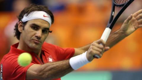 Roger Federer in action against Ilija Bozoljac in the Davis Cup