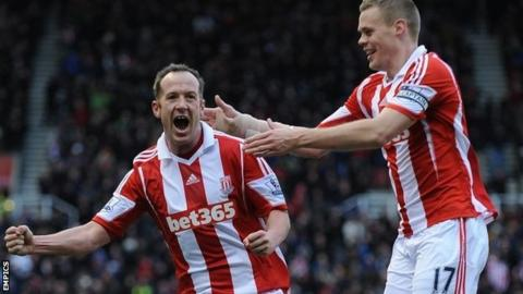 Charlie Adam celebrates after scoring Stoke's opening goal