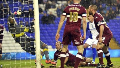 Federico Macheda (second right scores for Birmingham against Derby