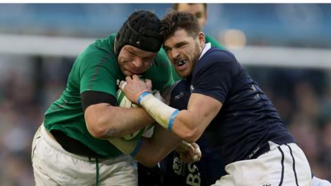 Prop Mike Ross comes up against Sean Lamont as Ireland emerge 22-point winners in their Six Nations opener