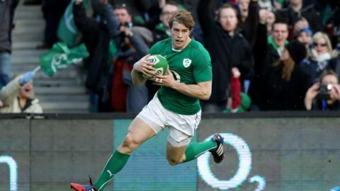 Winger Andrew Trimble prepares to touch down for the opening try of the game