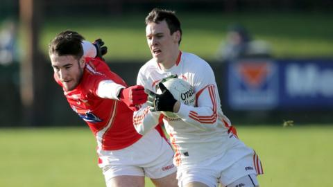Louth's Patrick Reilly in action against Armagh's Mark Shields as Armagh mount a comeback to secure a draw at Drogheda