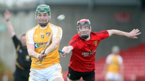 Antrim's Paul Shiels and Down's Ryan Brannigan in action during the 2013 Ulster Hurling final which Antrim won by 4-21 to 1-17