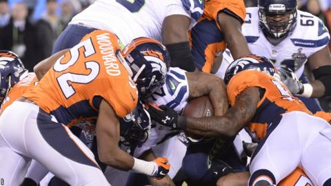 Seattle running back Marshawn Lynch bulldozes his way into the Denver endzone for Super Bowl XLVIII's first touchdown