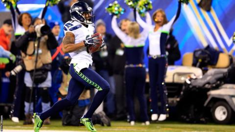 Seattle's Percy Harvin (right) returns the second-half kick-off 87 yards for a touchdown against Denver Broncos in Super Bowl XLVIII