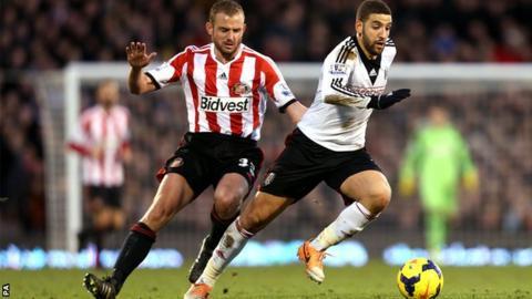 Sunderland midfielder Lee Cattermole (left) challenges Fulham's Adel Taarabt