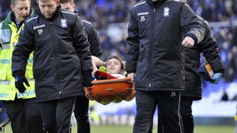 On-loan Birmingham City defender Tom Thorpe is stretchered off on his league debut at St Andrew's on Saturday