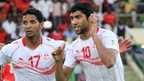 Tunisia's Issam Jomaa (left) and Oussama Darragi