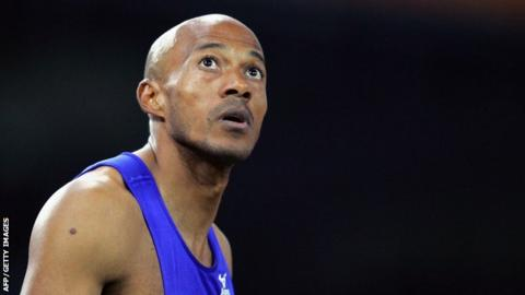 Frankie Fredericks of Namibia waiting for the results in the men's 200m semi-finals race one during the Olympic Games athletics competitions at the Olympic Stadium in Athens.