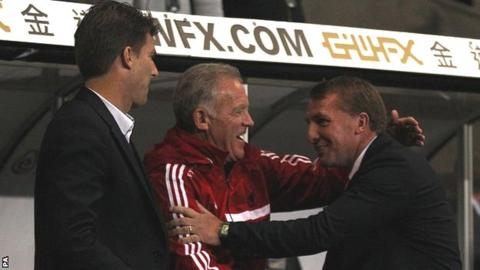 Brendan Rodgers (right) greets Michael Laudrup (left) and Alan Curtis on his return to Swansea