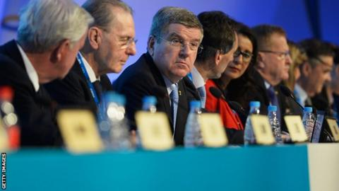 International Olympic Committee (IOC) President Thomas Bach (centre) attends the IOC meeting with former President Jacques Rogge (second left) ahead of the Sochi 2014 Winter Olympics