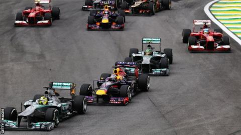 Nico Rosberg of Germany and Mercedes GP takes the lead from Sebastian Vettel of Germany and Infiniti Red Bull Racing at the start of the Brazilian Formula One Grand Prix 2013.