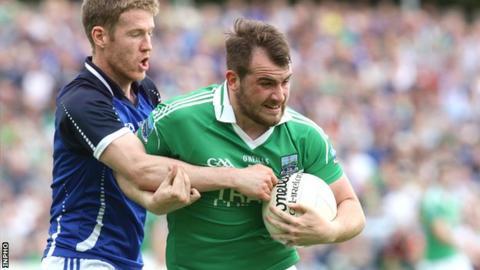 Cavan's Rory Dunne challenges Sean Quigley