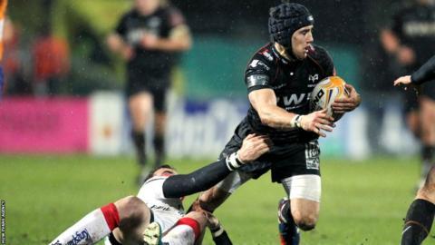 Ospreys fly-half Matthew Morgan tries to break free against Ulster in Belfast in the Pro12