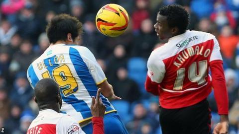 Brighton's Leonardo Ulloa heads in his side's winner against Doncaster