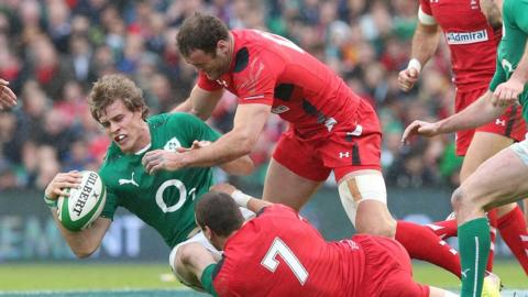 Ireland and Ulster winger Andrew Trimble in action against Welsh pair Jamie Roberts and Sam Warburton