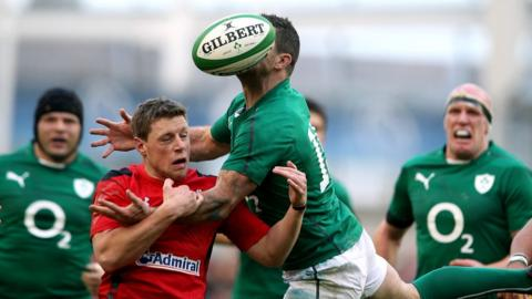 Rhys Priestland challenges for the ball as Ireland overcome Wales in a keenly anticipated Six Nations clash