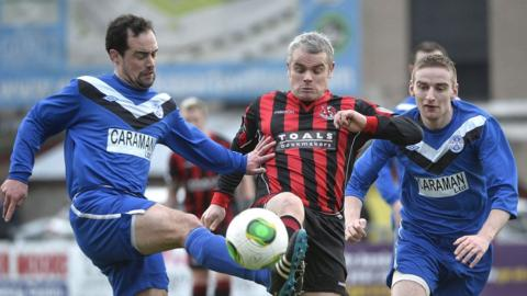 Diarmud Larkin challenges Gary McCutcheon during Crusaders' 4-0 win over Ballymoney United at Seaview