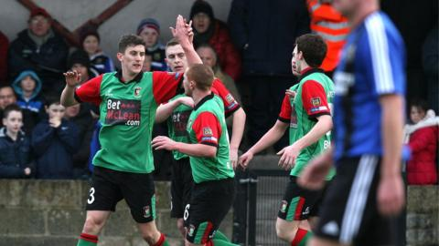 Marcus Kane is congratulated after scoring Glentoran's goal against Armagh City at Holm Park