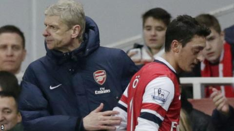 Arsenal's Arsene Wenger and Mesut Ozil