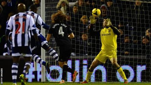West Brom striker Victor Anichebe scores against Chelsea