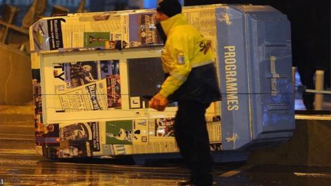 Manchester City's programme kiosk takes a tumble