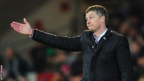 Ole Gunnar Solskjaer gesticulates to his players during a game