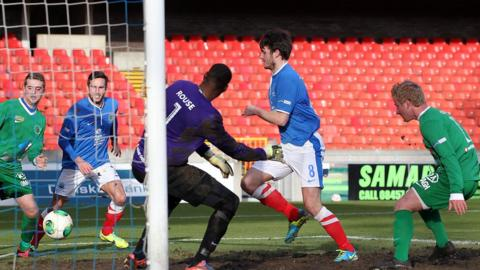 Philip Lowry scores the first of Linfield's six goals against Ballinamallard at Windsor Park