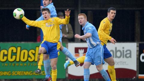 Stefan Lavery wins an aerial battle for Dungannon as they beat Warrenpoint Town 1-0