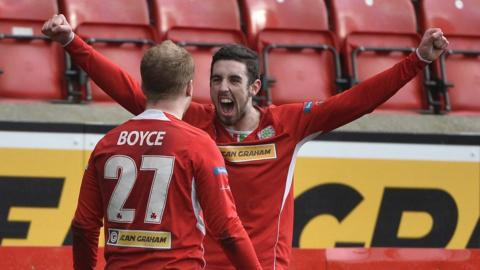 Liam Boyce and Joe Gormley celebrate one of their team's four goals against Crusaders at Solitude