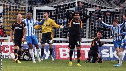 Newport players show their despair following Hartlepool's second goal