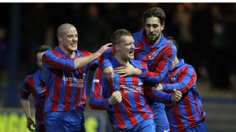 Ards goalscorer David Gibson is joined by Ards team-mates Mark McClelland and David Gibson