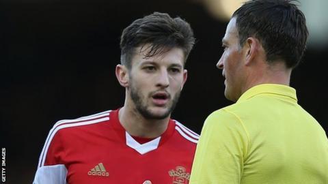 Mark Clattenburg (right) talks to Southampton's Adam Lallana