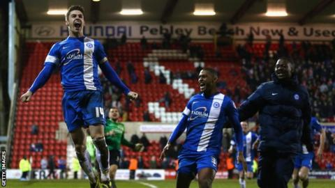 Peterborough United celebrate going to Wembley