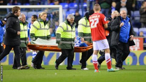 Wigan midfielder Ben Watson is stretchered off against Barnsley