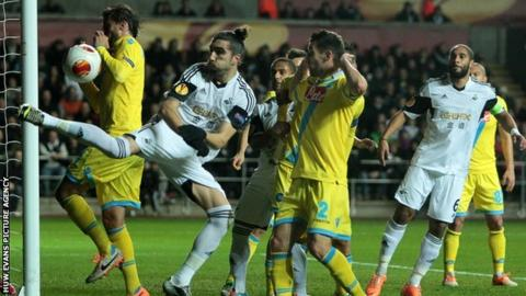 Swansea's Chico Flores in action against Napoli