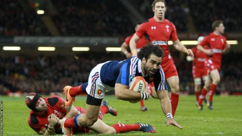 France wing Yoann Huget crossses for a try but the score is disallowed following an earlier knock on.