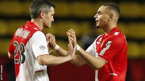 Monaco's French defender Layvin Kurzawa (right) celebrates with midfielder Jeremy Toulalan