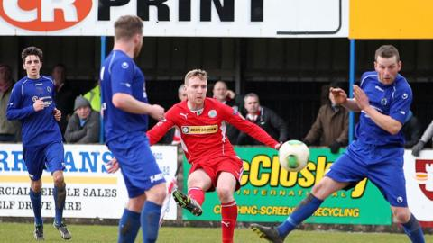 Chris Curran tries his luck with a shot at goal during the Irish Premiership match at Dungannon