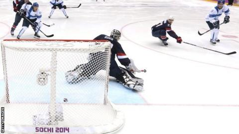 Teemu Selanne #8 of Finland shoots and scores against Jonathan Quick