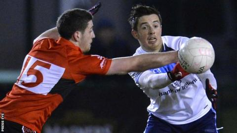 UCC forward Paul Geaney challenges UUJ's Ronan O'Neill in the final